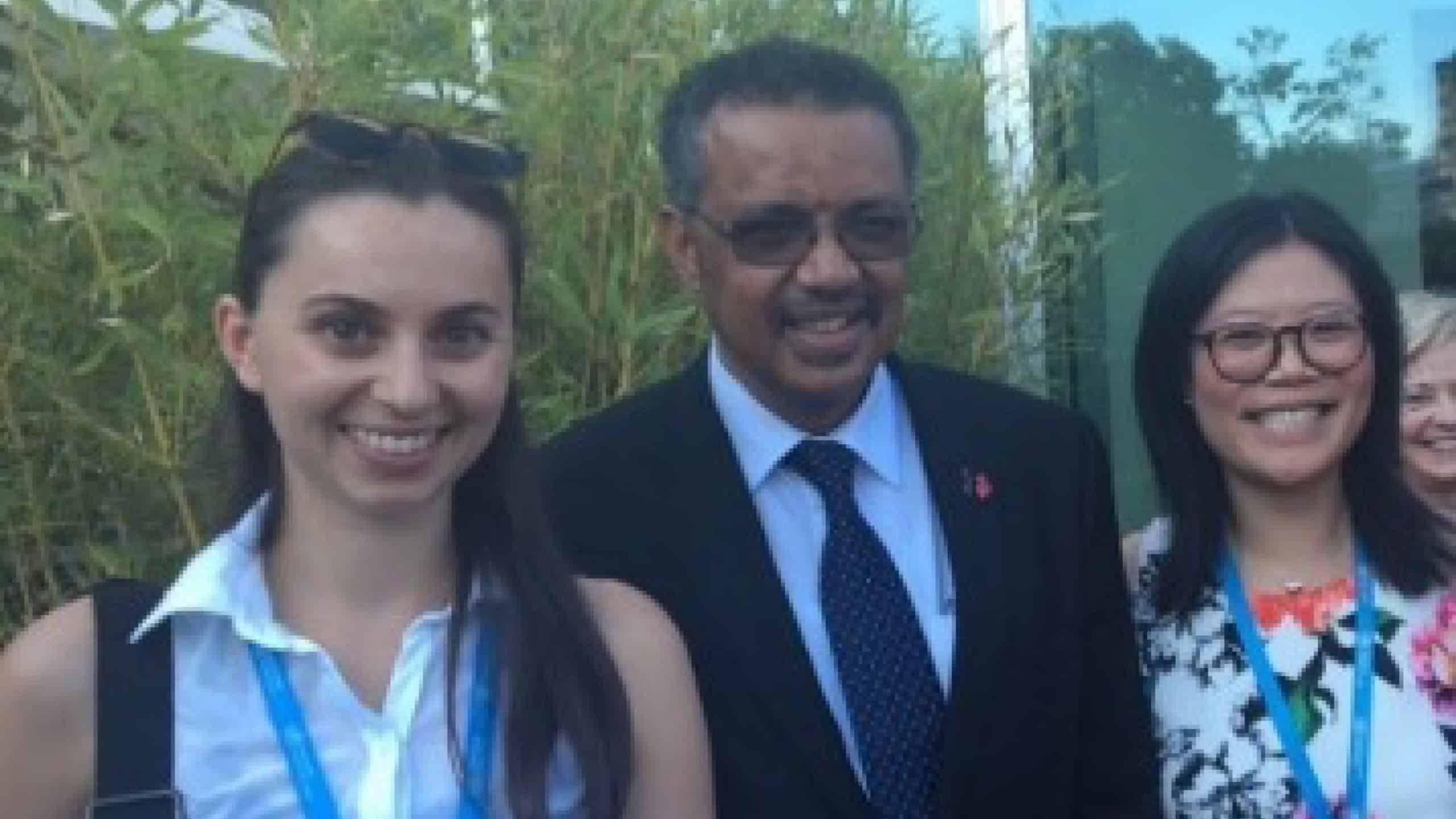 Drs Carmen Hagen (Switzerland) at left and Natalie Yap (Australia) with WHO Director-General Dr Tedros Adhanom.