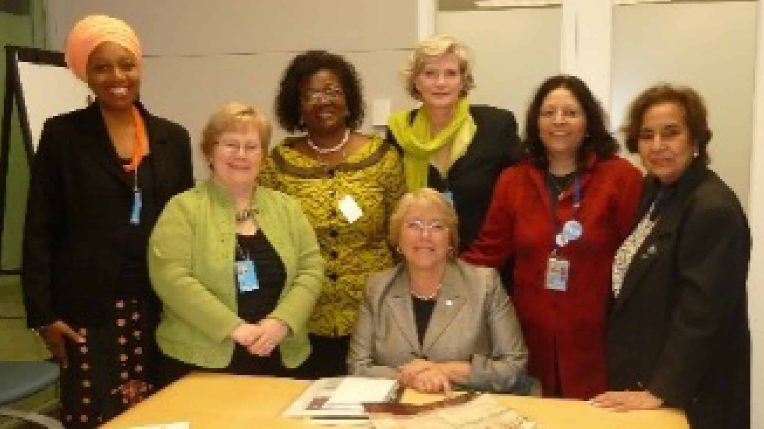 Eleanor Nwadinobi, Shelley Ross, Afua Hesse, Claudia Morrissey, Padmini Murthy and Satty Keswani with Michelle Bachelet, Former President of Chile